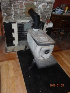 Free standing wood stove fixed