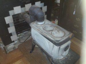 free standing wood stove broken